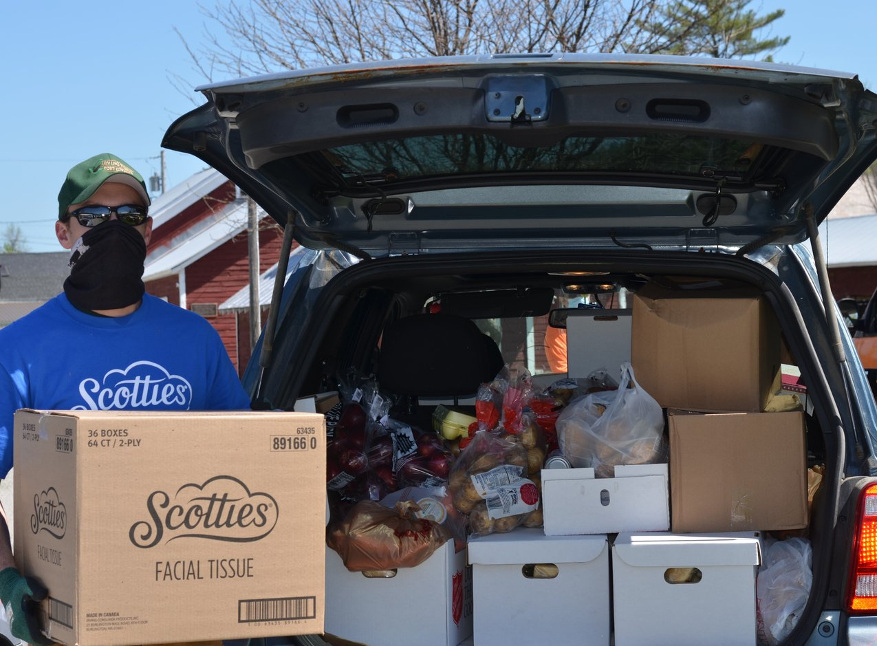 Scotties employees hand out tissues, food and other necessities to locals at the contactless, drive-thru food pantry on Friday, May 22. Washington County Fairgrounds, NY